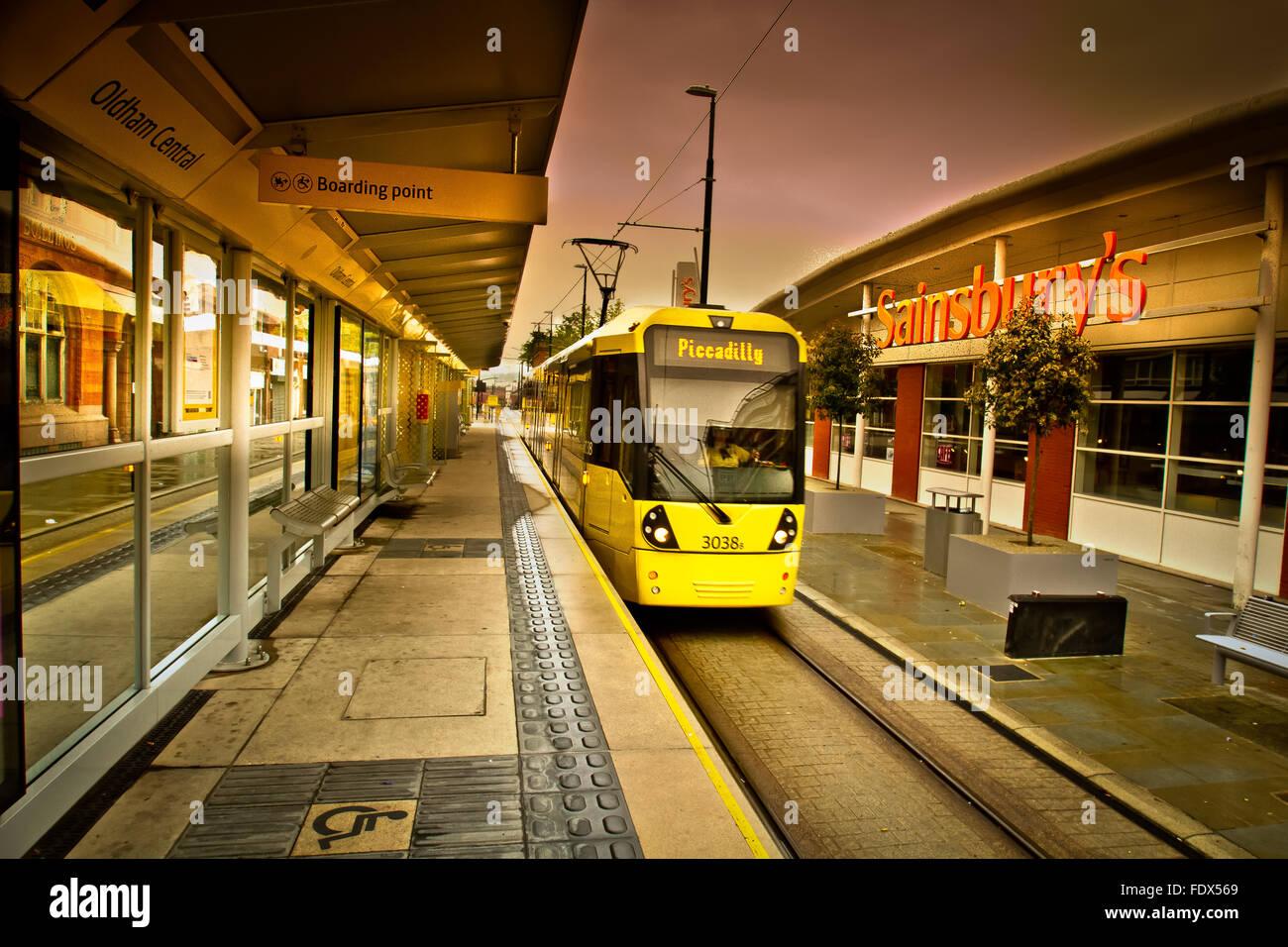 Tram arriving at Oldham Central Station, Lancashire, UK - Stock Image