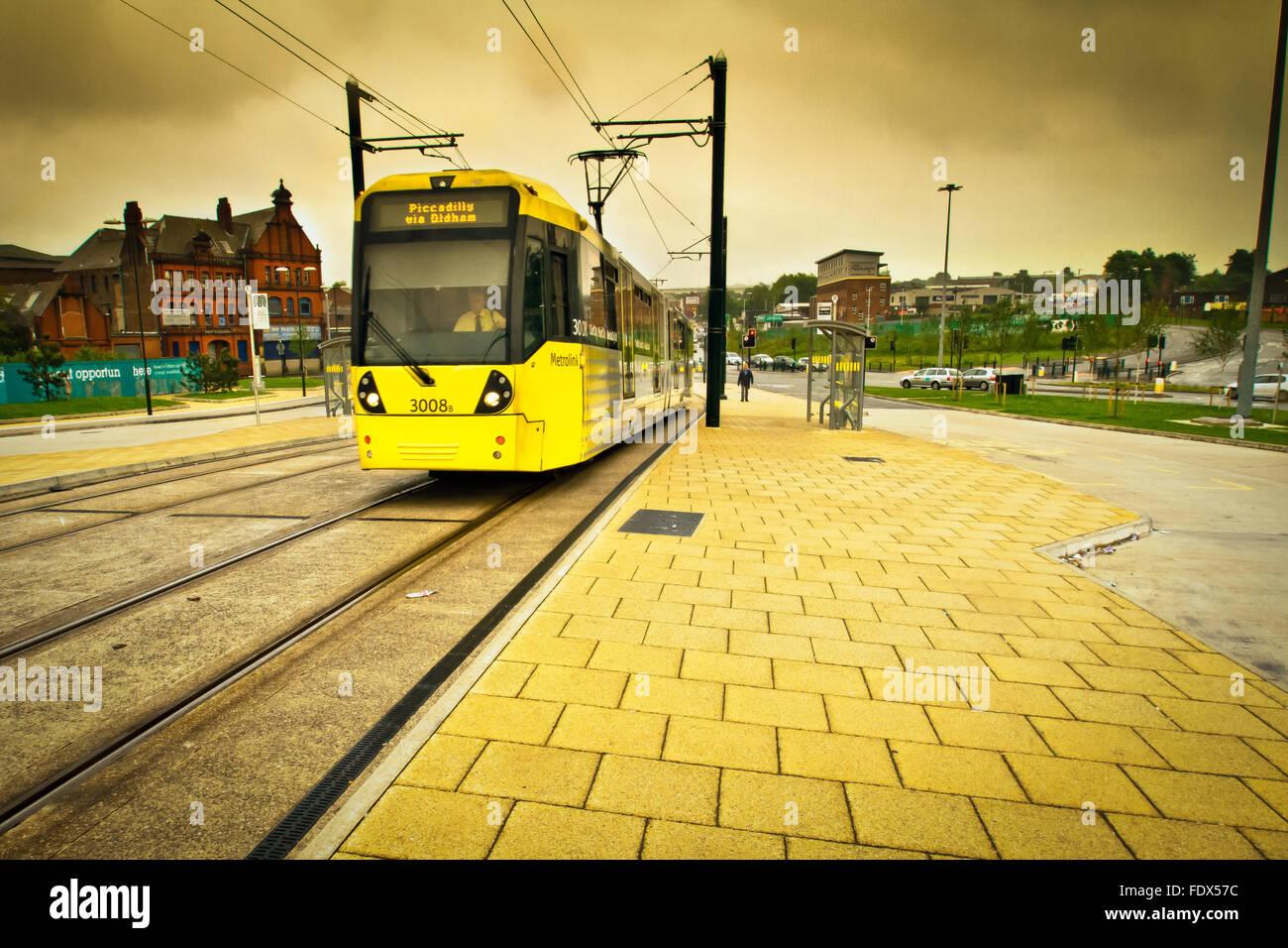 Tram arriving at Mumps Bridge, Oldham, Lancashire, UK - Stock Image