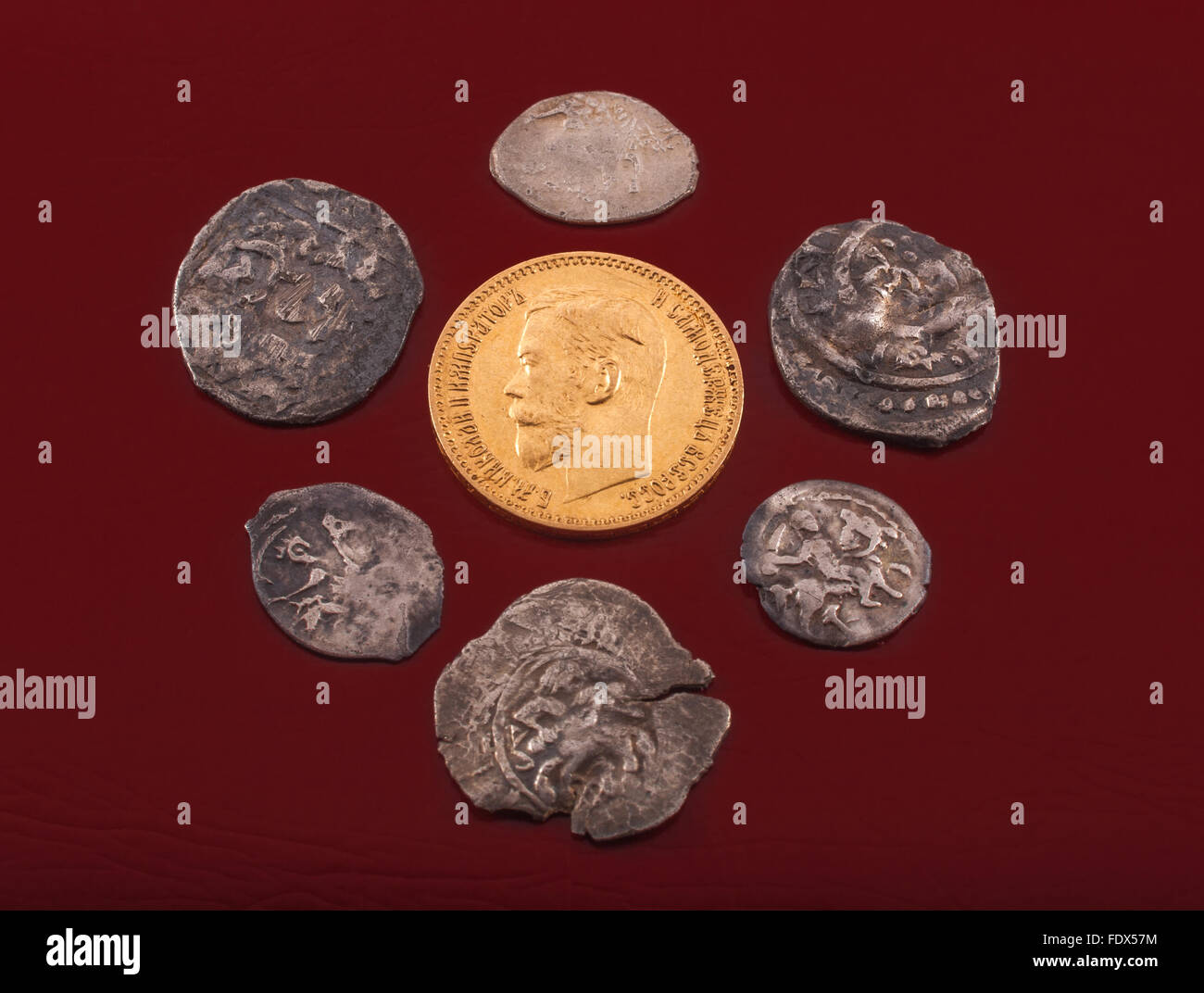 Evolution of the Russian money - silver Moscow and udel kopek and gold 5 rubles of Nikolay Romanov - Stock Image