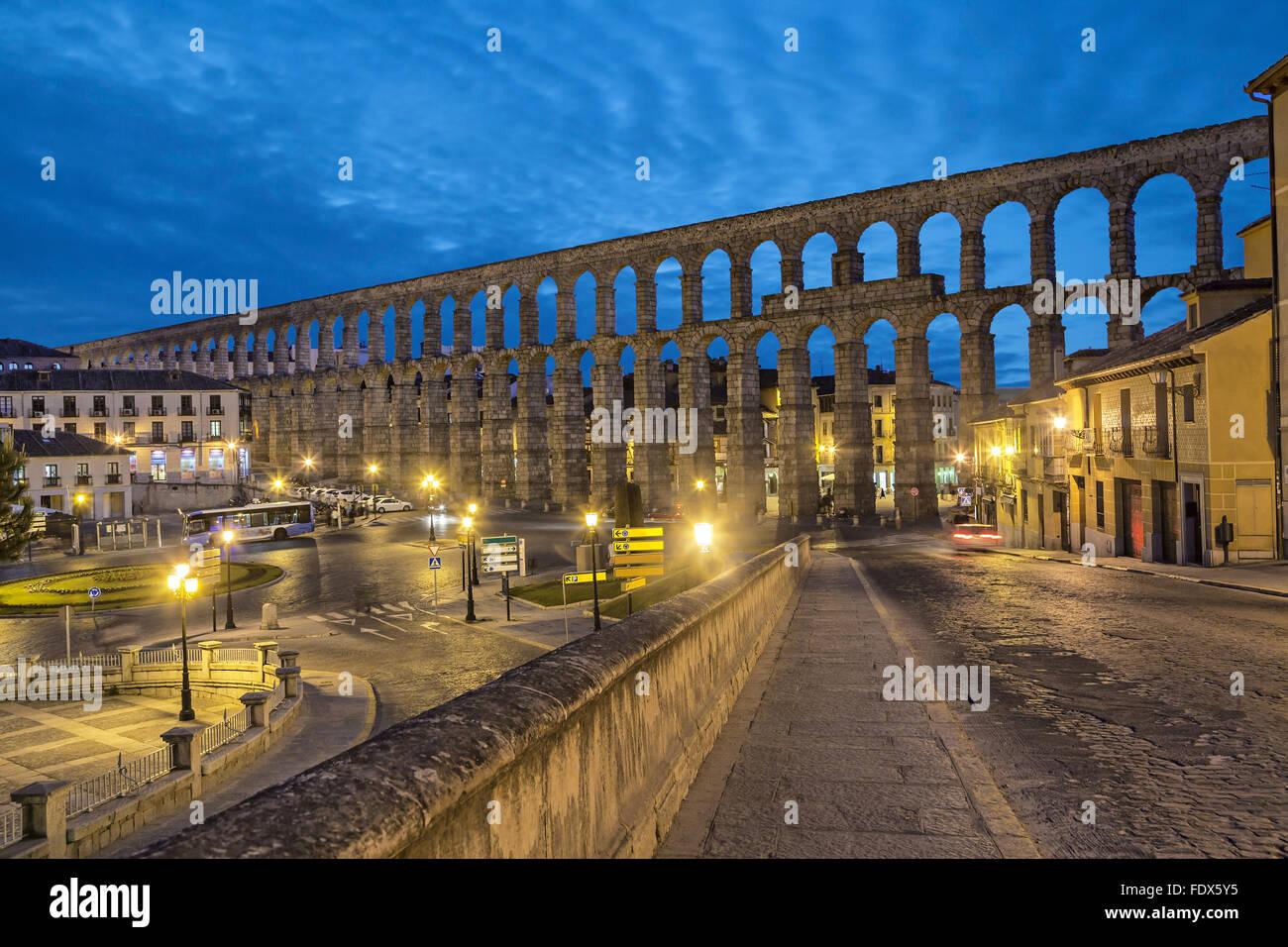 Ancient Roman aqueduct on Plaza del Azoguejo square in Segovia, Spain - Stock Image