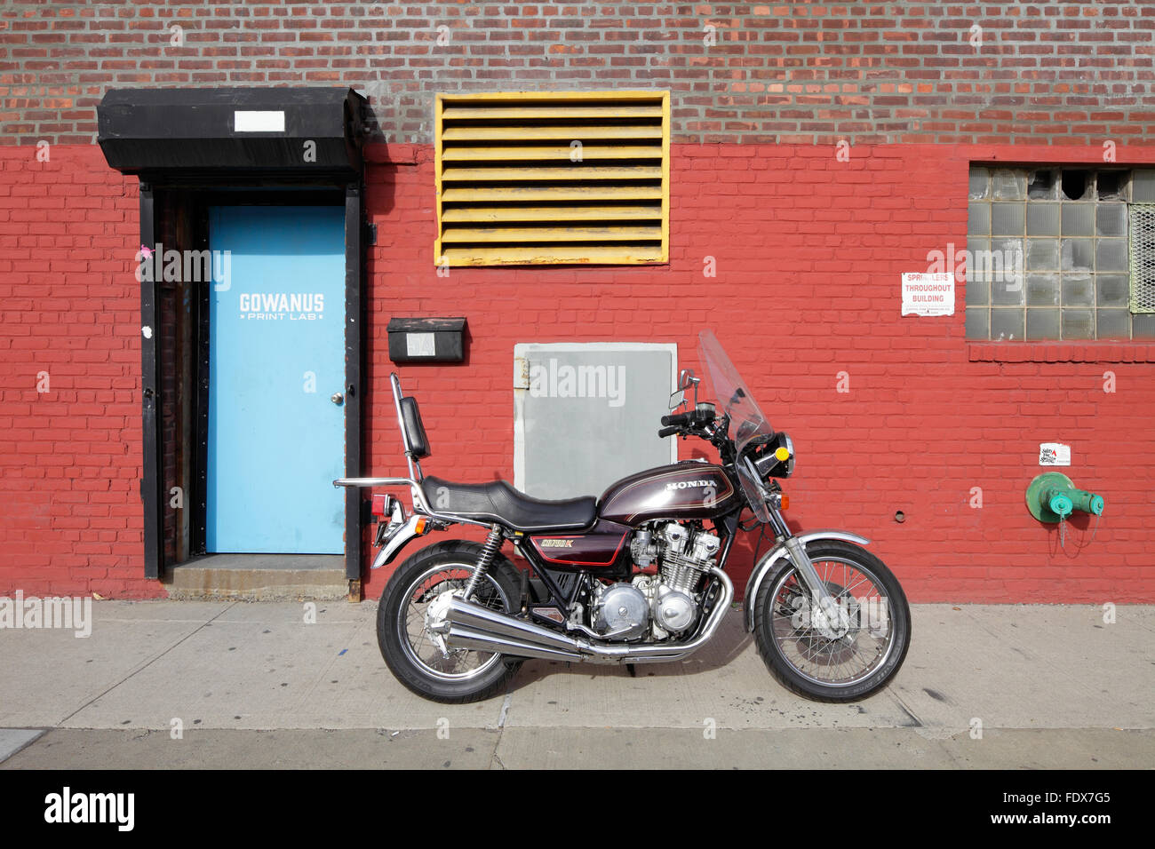New York City, USA, a Honda parked in front of a house - Stock Image