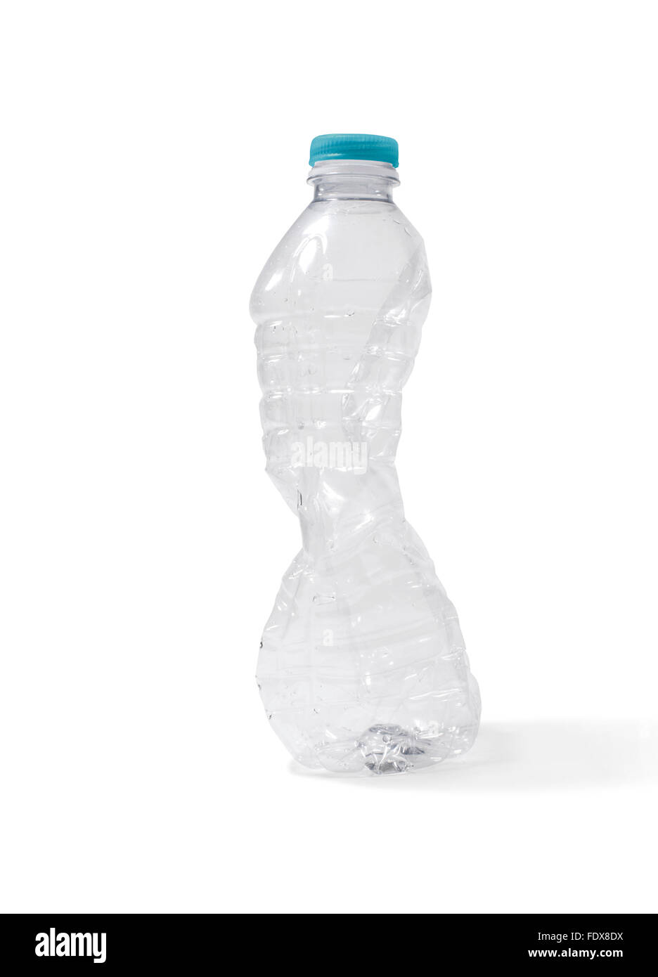 Studio shot of a crushed plastic water bottle - Stock Image
