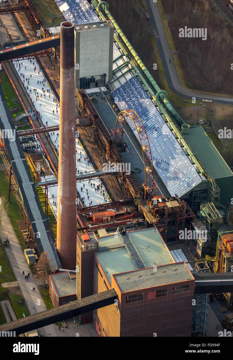 Coking plant, Zeche Zollverein, ice rink, ice skaters, industrial scene, Essen, Ruhr district, North Rhine-Westphalia, - Stock Image