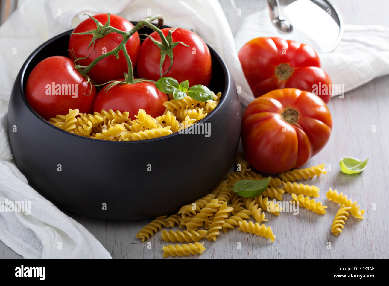 Ingredients for tomato soup with fusilli pasta - Stock Image