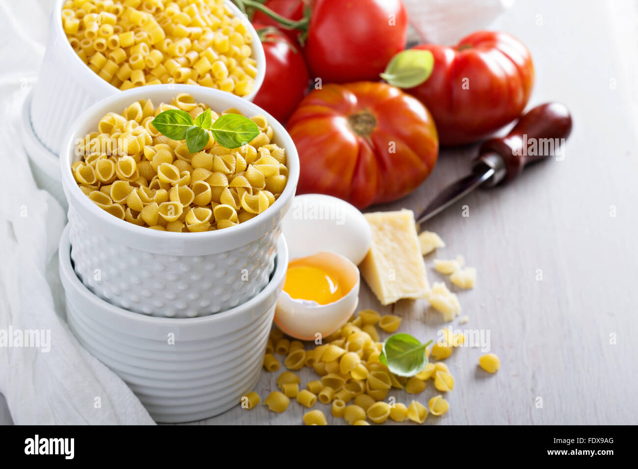 Ingredients for cooking pasta casserole with eggs and cheese - Stock Image