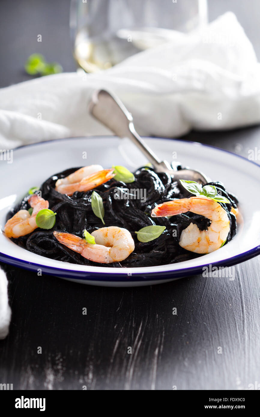 Squid ink homemade pasta with shrimp basil - Stock Image