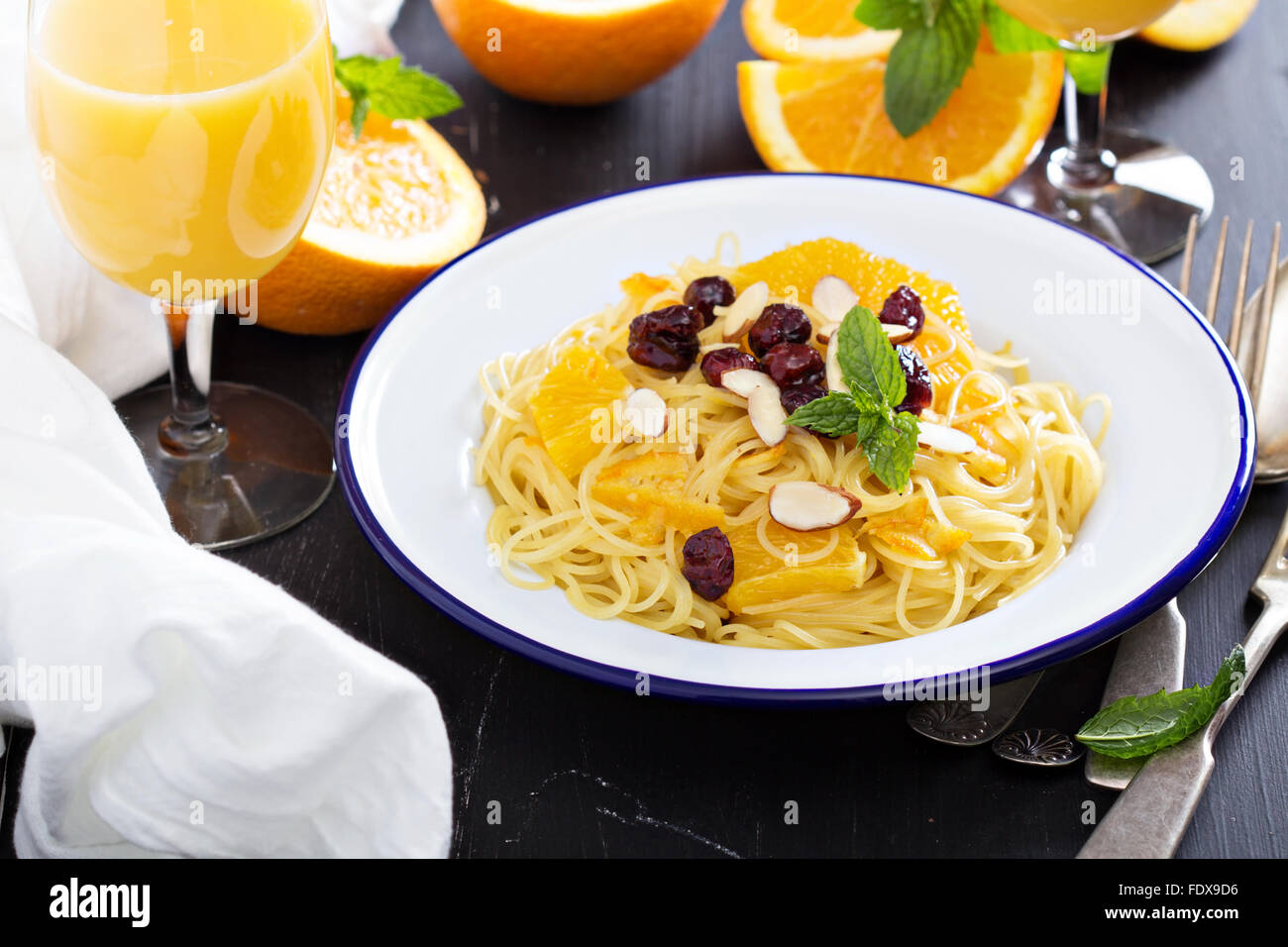 Dessert pasta with orange and dried cherry - Stock Image