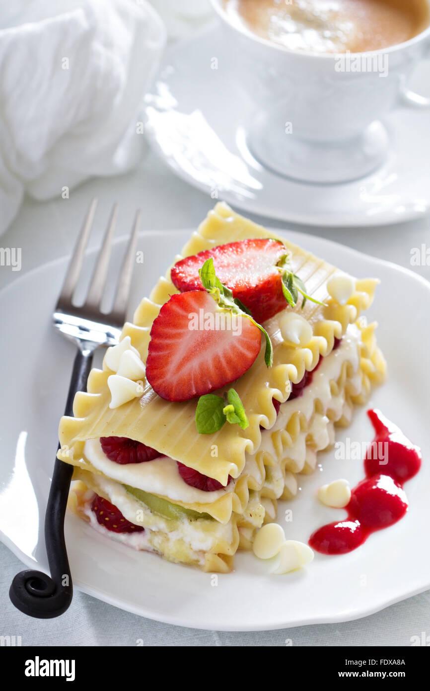 Dessert lasagna with berries and kiwi fruit - Stock Image