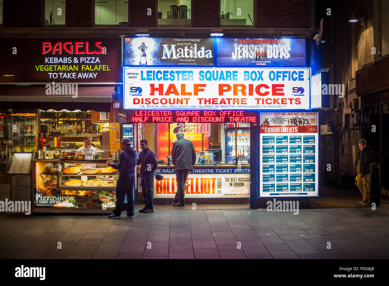 Leicester Square box office and bagel shop at night, London - Stock Image