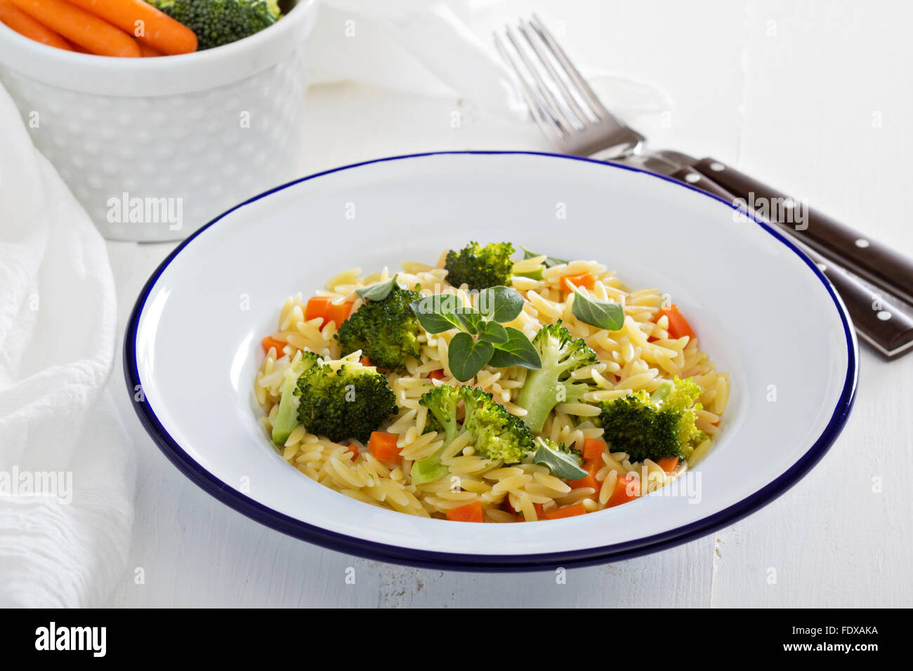 Pasta with broccoli and carrot cooked in stock - Stock Image