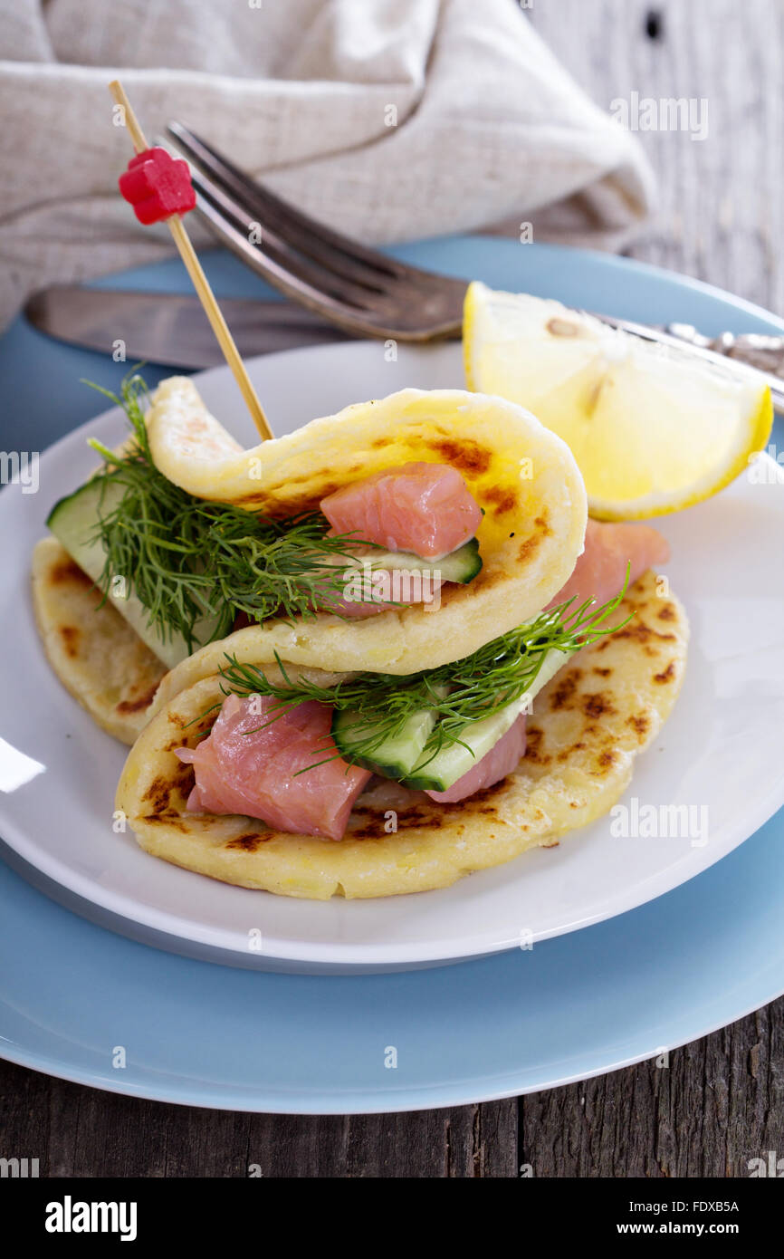 Scandinavian potato pancakes with salmon, dill and cucumber - Stock Image
