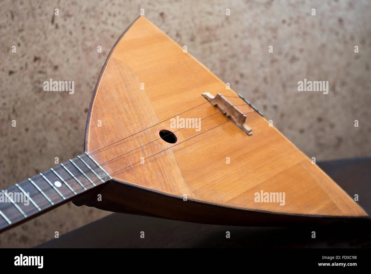 The balalaika is a Russian stringed musical instrument - Stock Image
