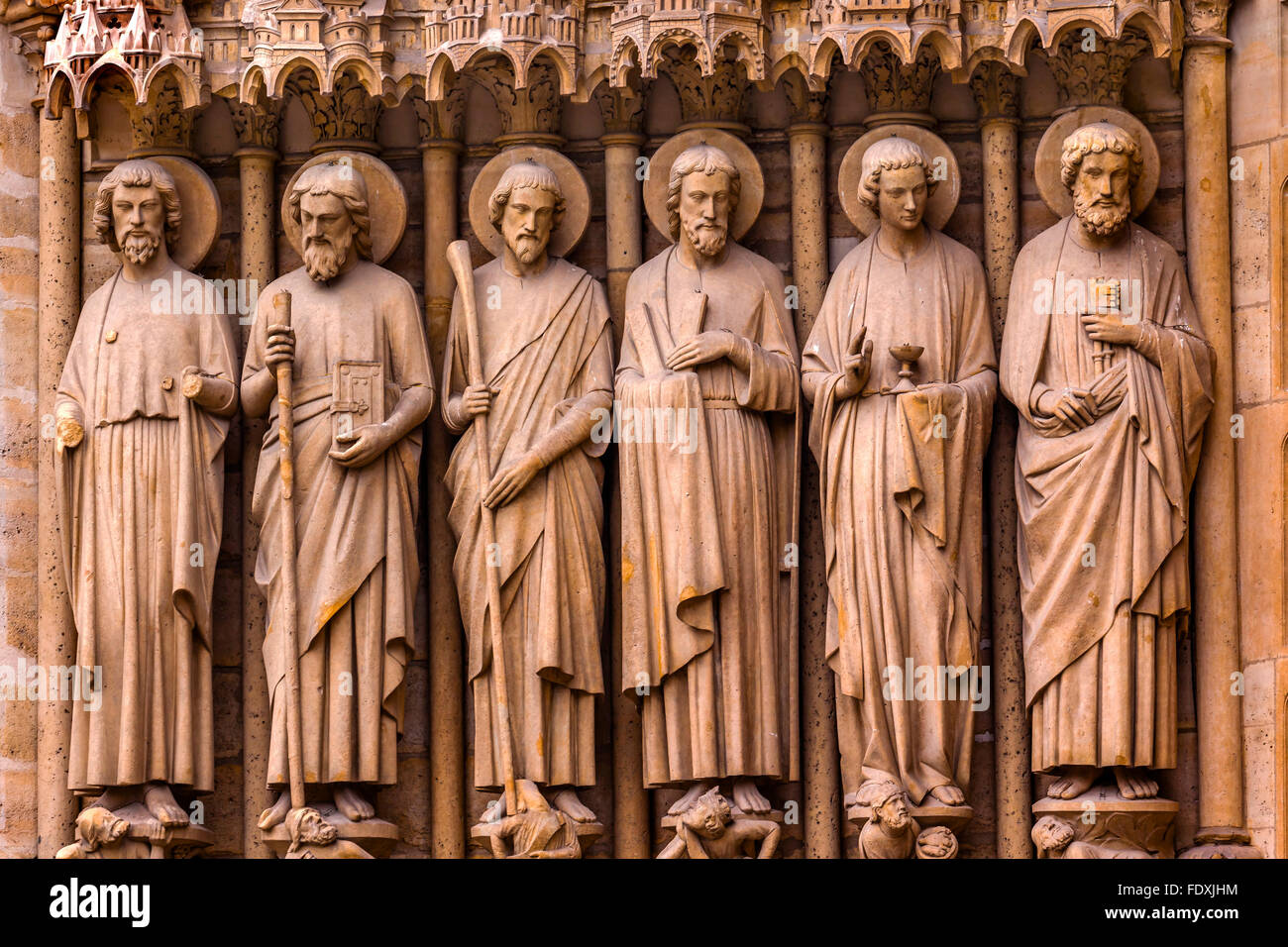 Biblical Saint Statues Door Notre Dame Cathedral Paris France.  Notre Dame was built between 1163 and 1250 AD. - Stock Image