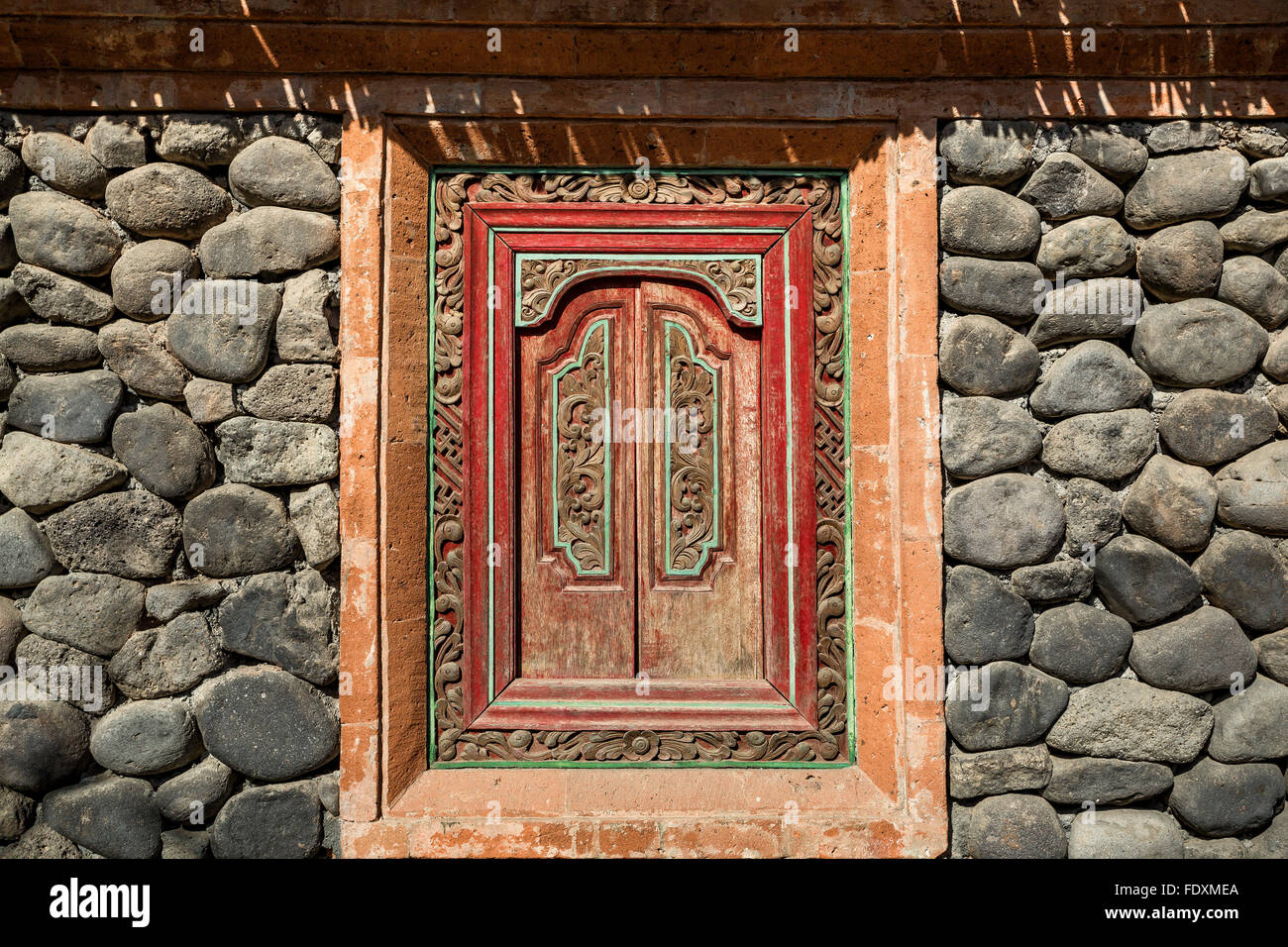 Bali Ethnic wooden crafted window - Stock Image