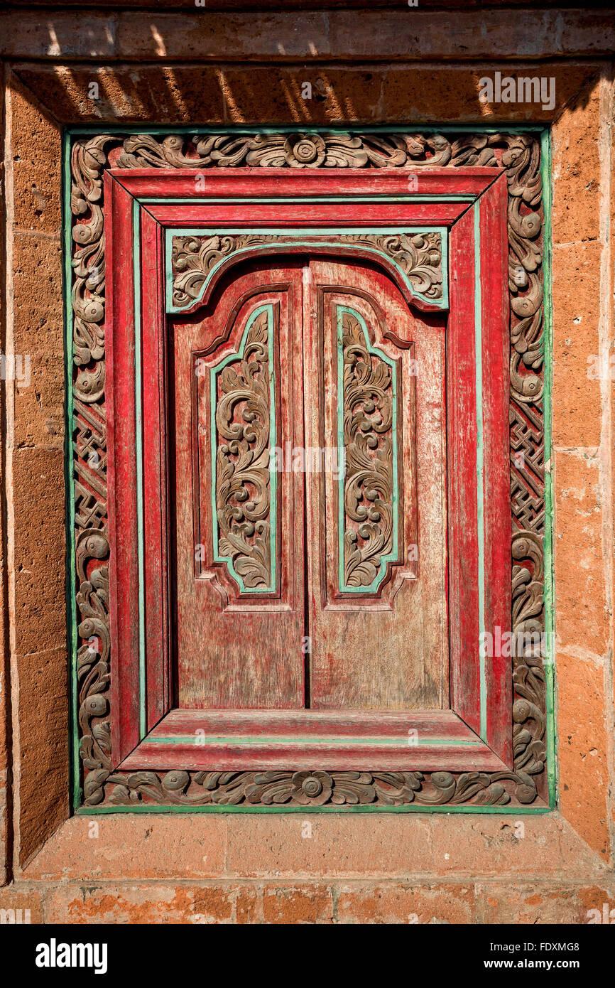 Bali Ethnic wooden crafted door - Stock Image
