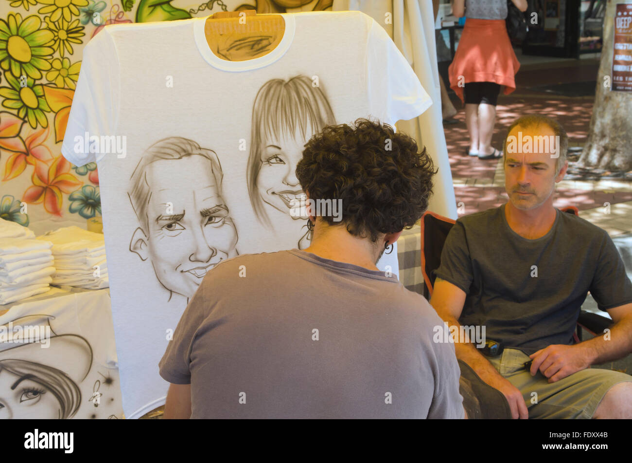 b79585ac Air brush artist working on caricature portraits onto a t shirt at Tamworth  Country Music Festival -