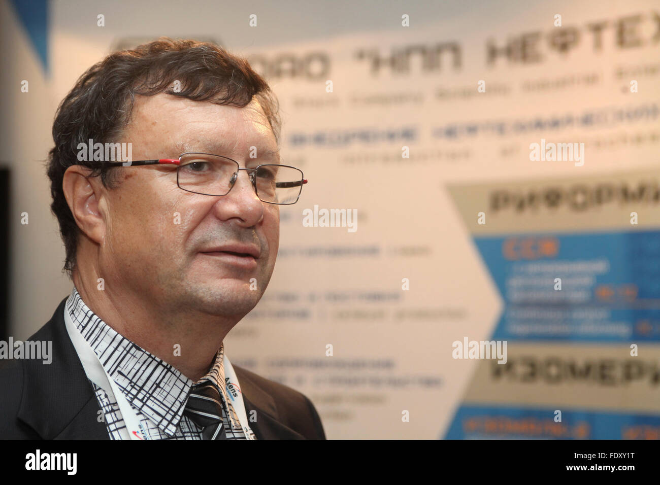 One of Russia's leading petrochemical engineers Dr Alexander Shakun pictured near boot of his company NPP Neftehim - Stock Image