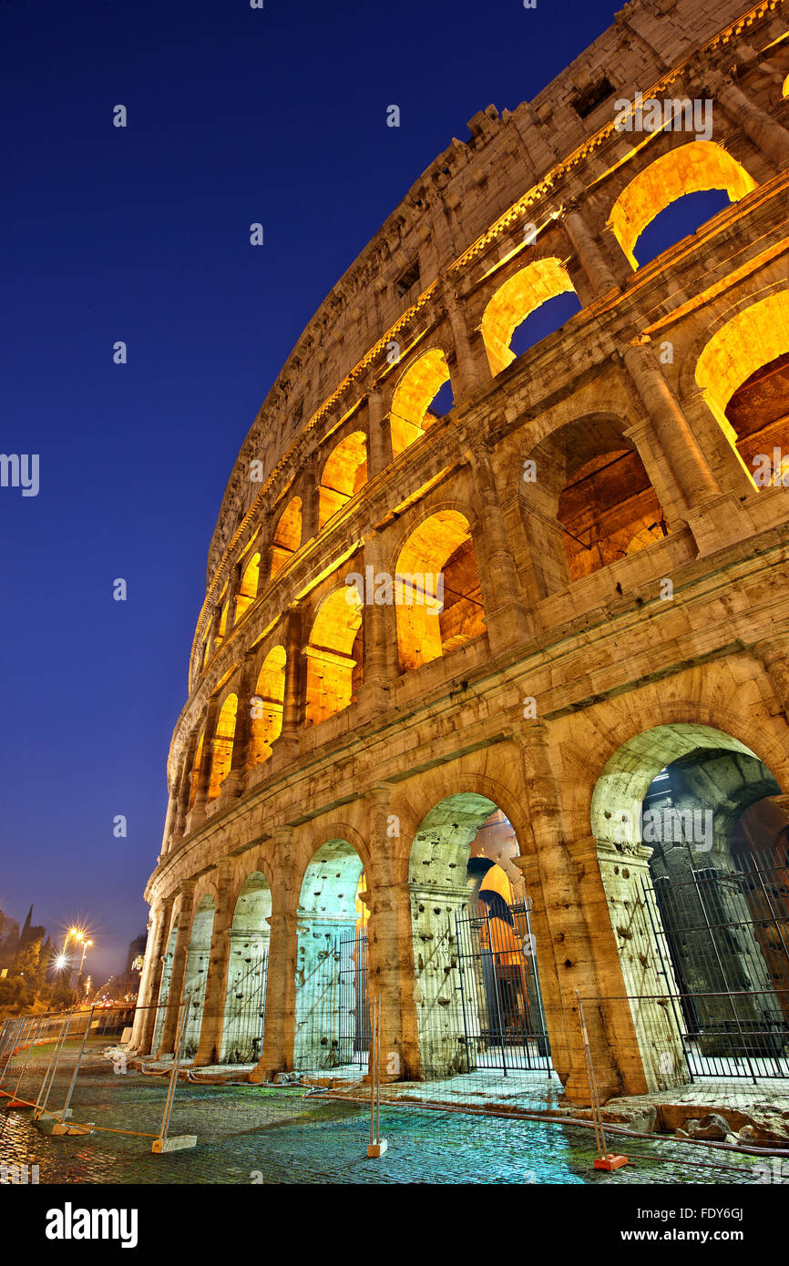 Night view of the Colosseum also known as the Flavian Amphitheater, Rome, Italy - Stock Image