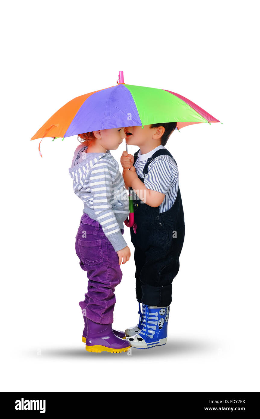 little boy and little girl together under the umbrella of color on