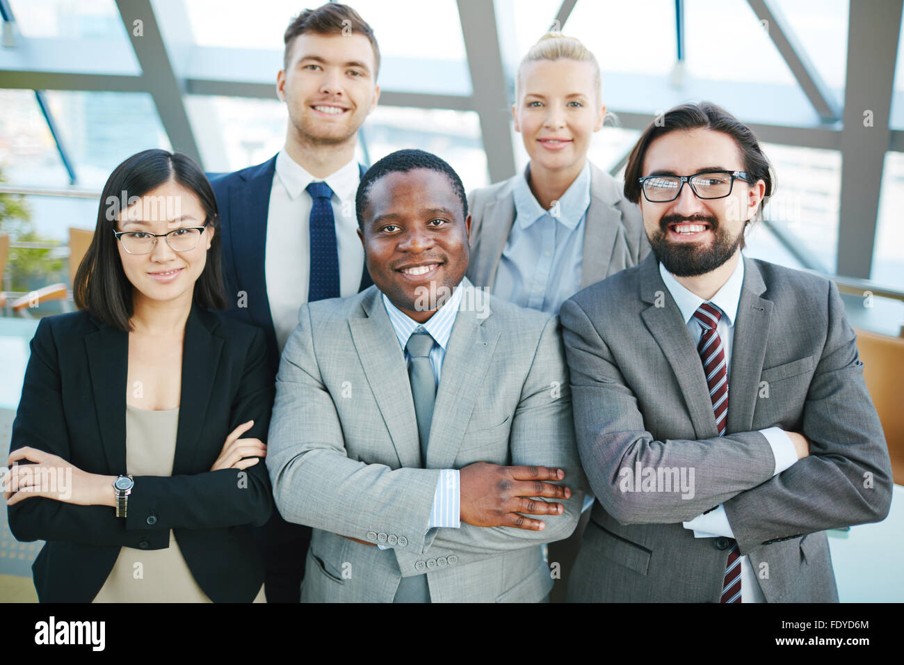 Successful managers looking at camera with smiles - Stock Image