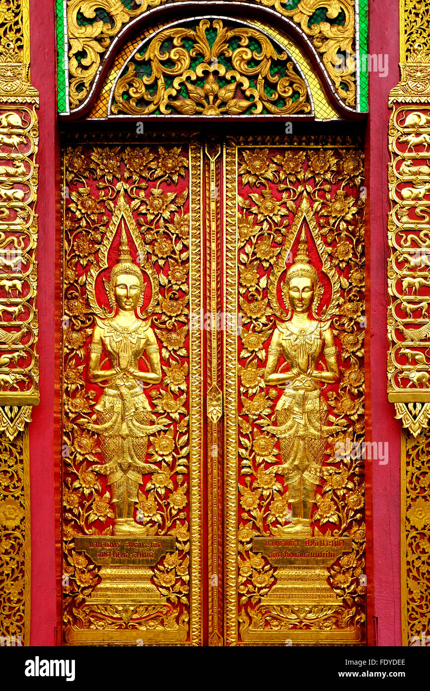 Wood carvings on a temple door of Wat Fon Soi, Chiang Mai, Thailand - Stock Image