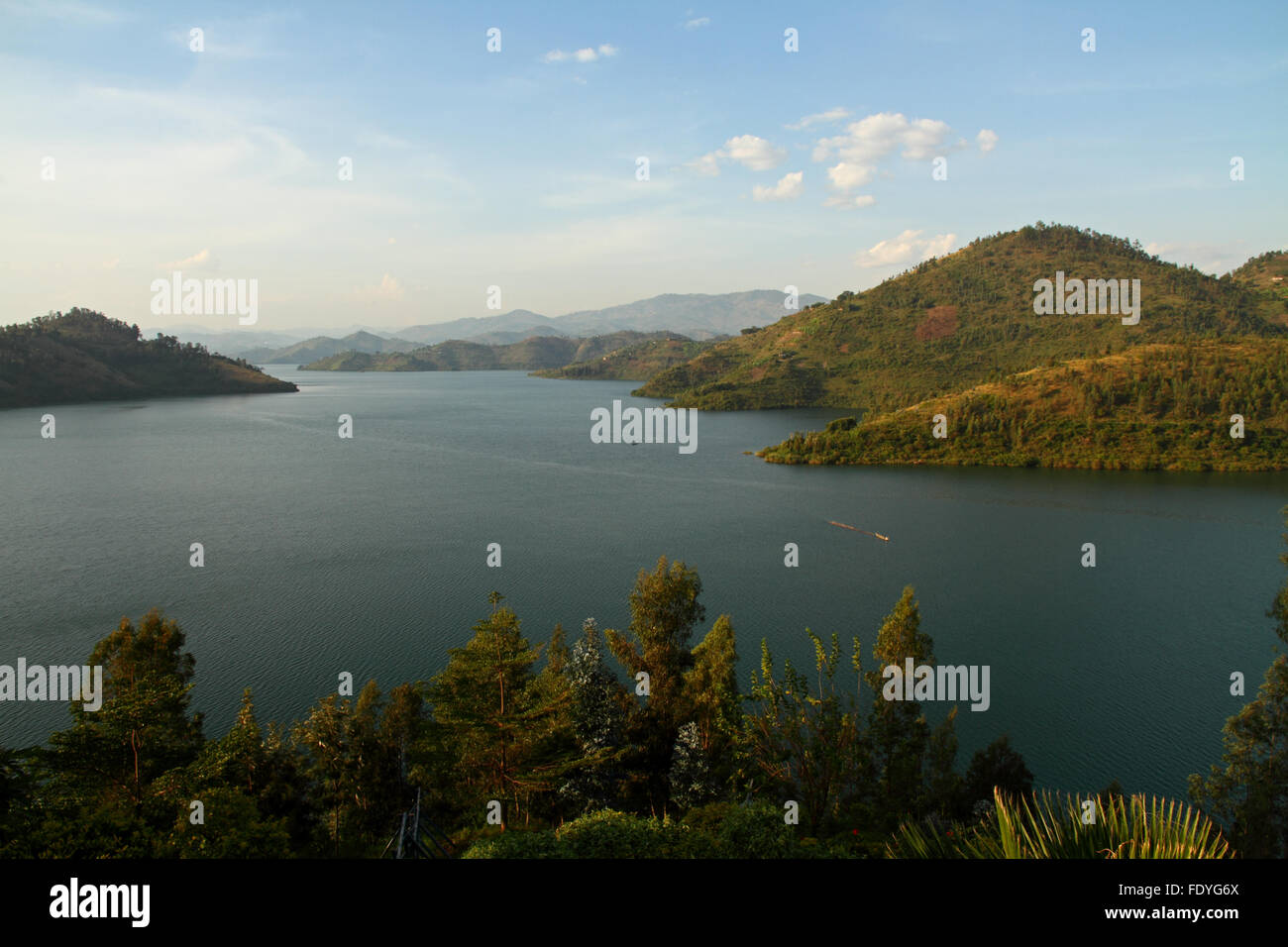 Lake Kivu set amongst rolling hills fading into the horizon in Rwanda, Africa - Stock Image