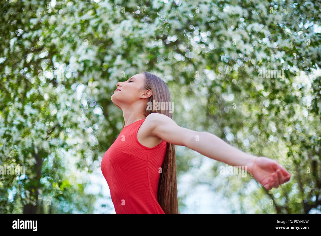 Delighted girl enjoying summer day - Stock Image