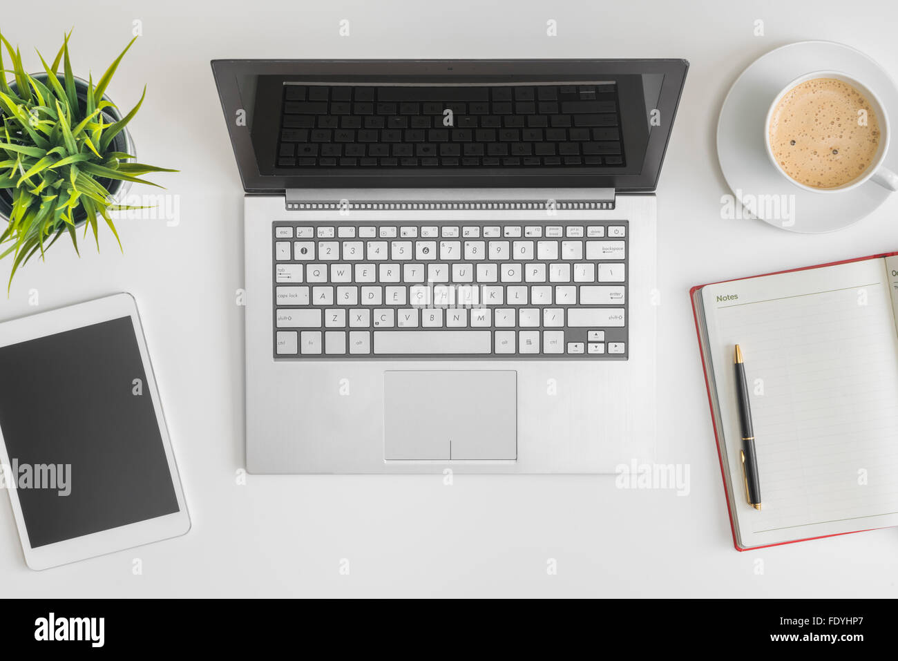 Flat lay photo of office desk - Stock Image