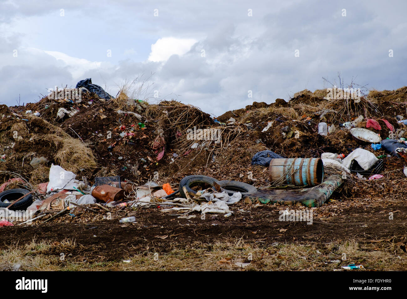 Disposed garbage polluting environment near a village in Transyilvania, Romania. - Stock Image