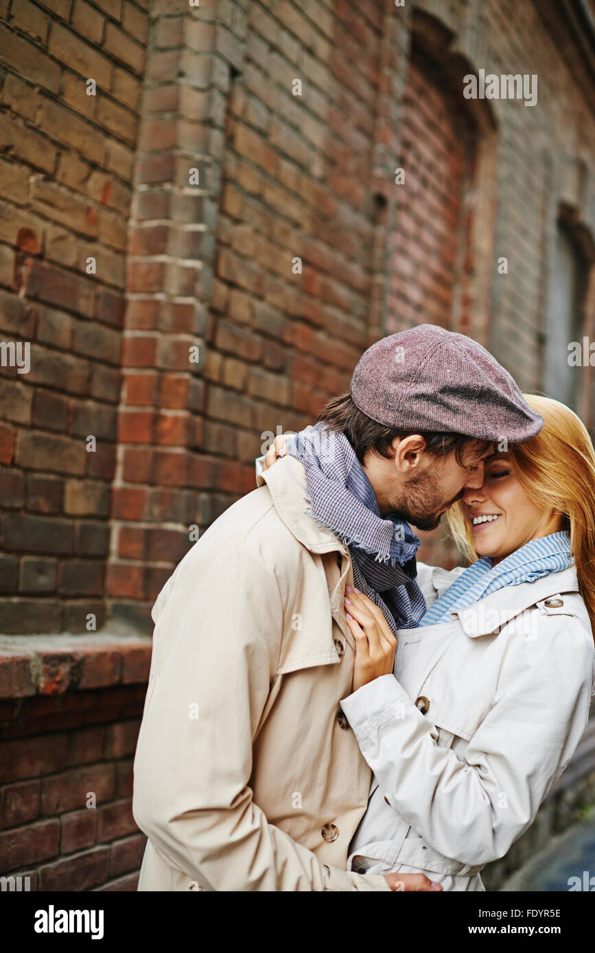 Romantic valentines embracing outdoors - Stock Image