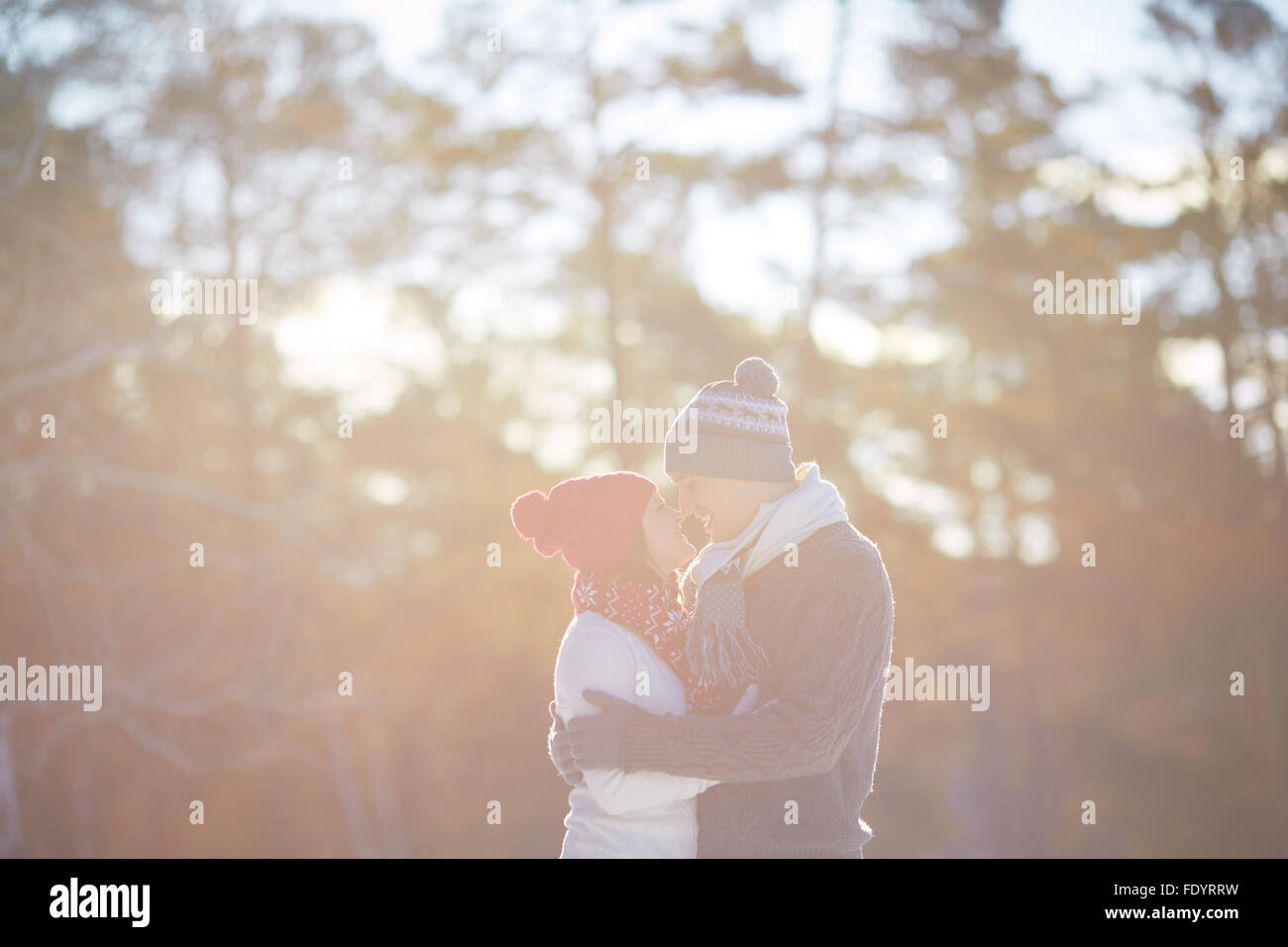 Young valentines standing nose to nose in natural environment - Stock Image