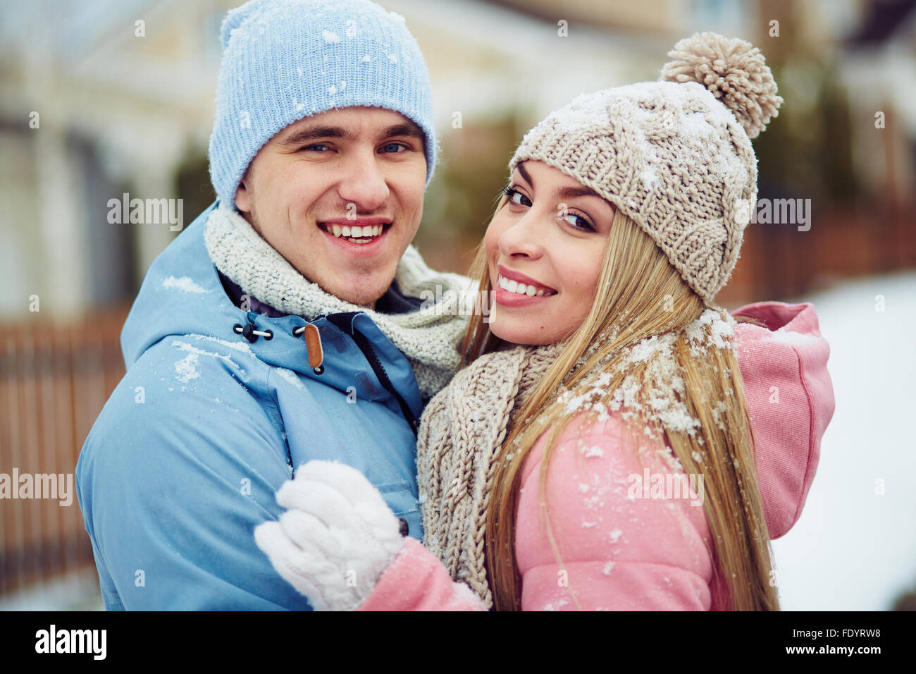 Young dates looking at camera with toothy smiles - Stock Image