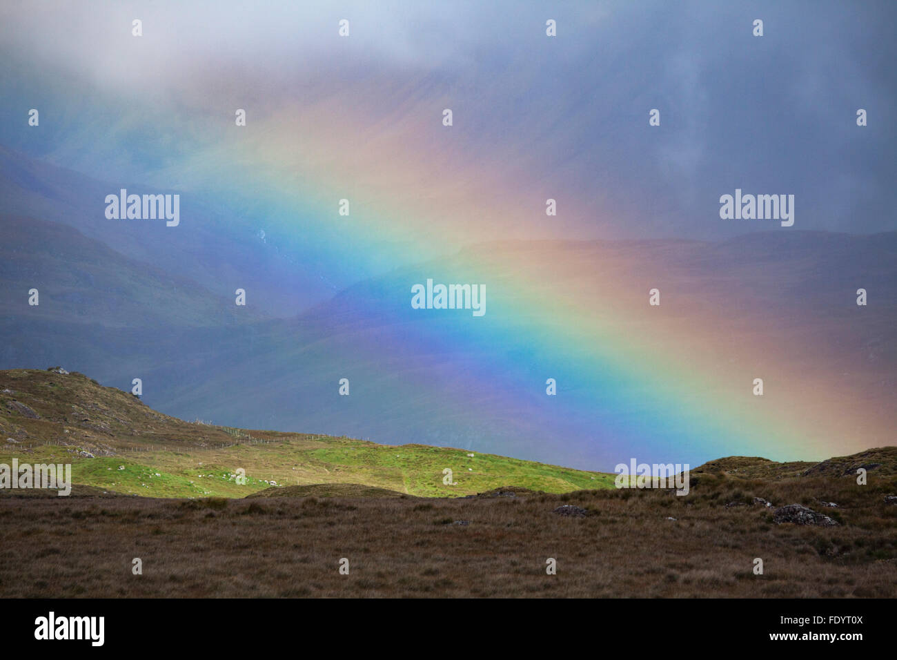 Mountain rainbow, County Galway, Ireland. - Stock Image