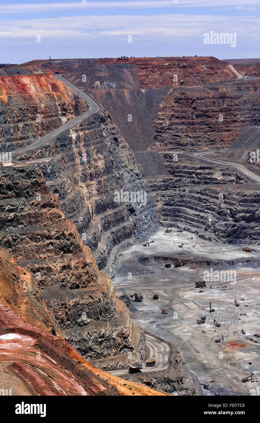 Western Australia Super Pit gold open mine in Kalgoorlie - Boulder town. VErtical view of deep dug bottom to top - Stock Image
