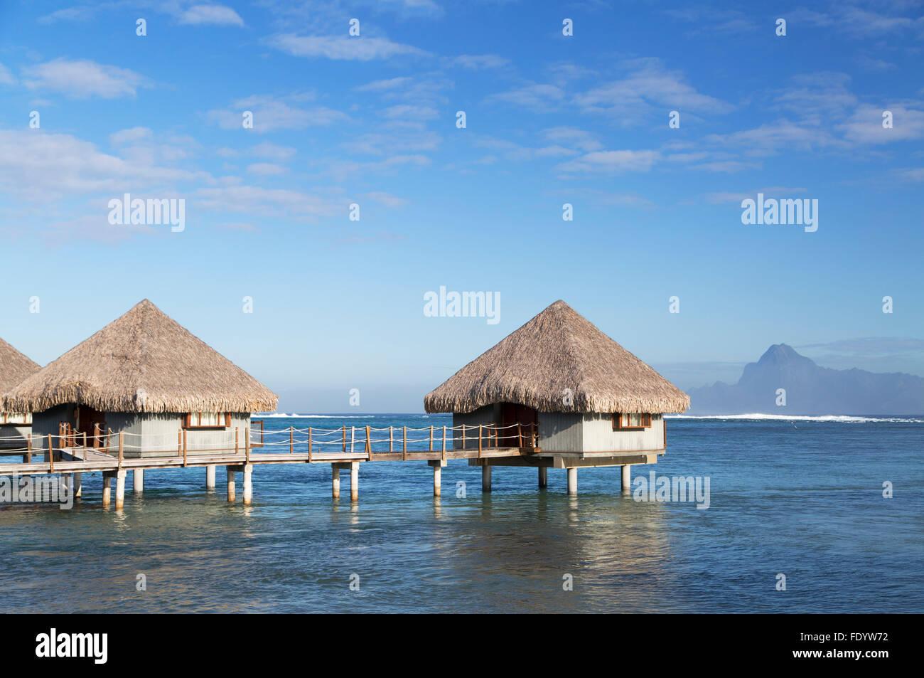 Overwater bungalows at Le Meridien Tahiti Hotel, Pape'ete, Tahiti, French Polynesia - Stock Image