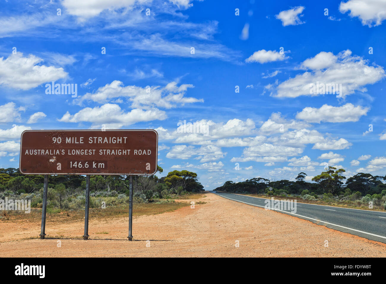 brown information roadsign in Western Australia nullarbor plain along Eyre highway about 90 mile straight road ahead - Stock Image