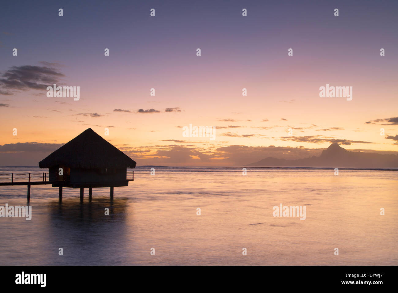 Overwater bungalow at Le Meridien Tahiti Hotel at sunset, Pape'ete, Tahiti, French Polynesia - Stock Image