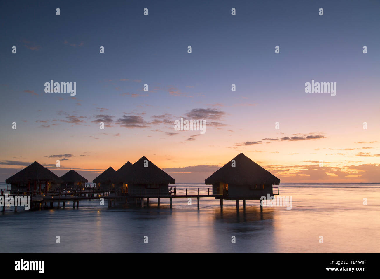 Overwater bungalows at Le Meridien Tahiti Hotel at sunset, Pape'ete, Tahiti, French Polynesia - Stock Image