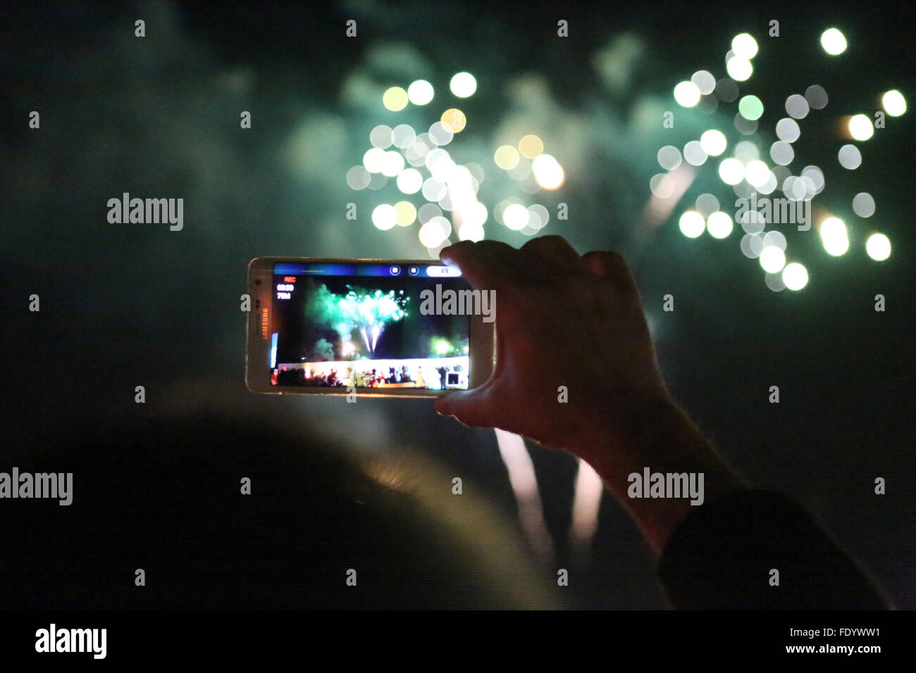 Dubai, United Arab Emirates, fireworks is photographed with a smartphone - Stock Image