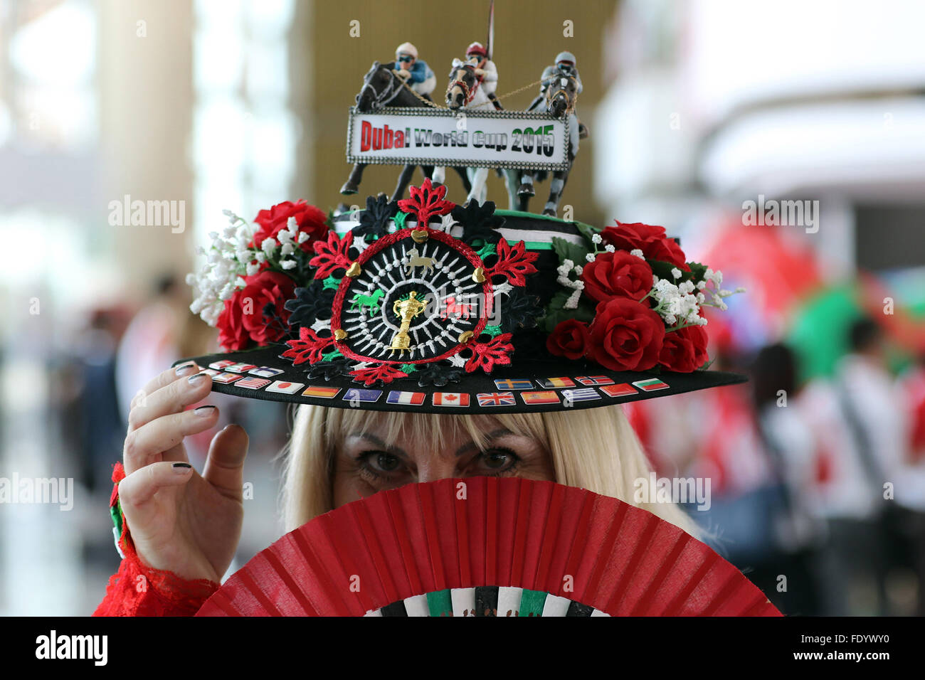 dubai, united arab emirates, woman with homemade hat at the races