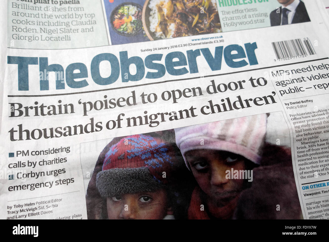Observer newspaper headline 'Britain poised to open door to thousands of migrant children'  24 Jan 2016London - Stock Image