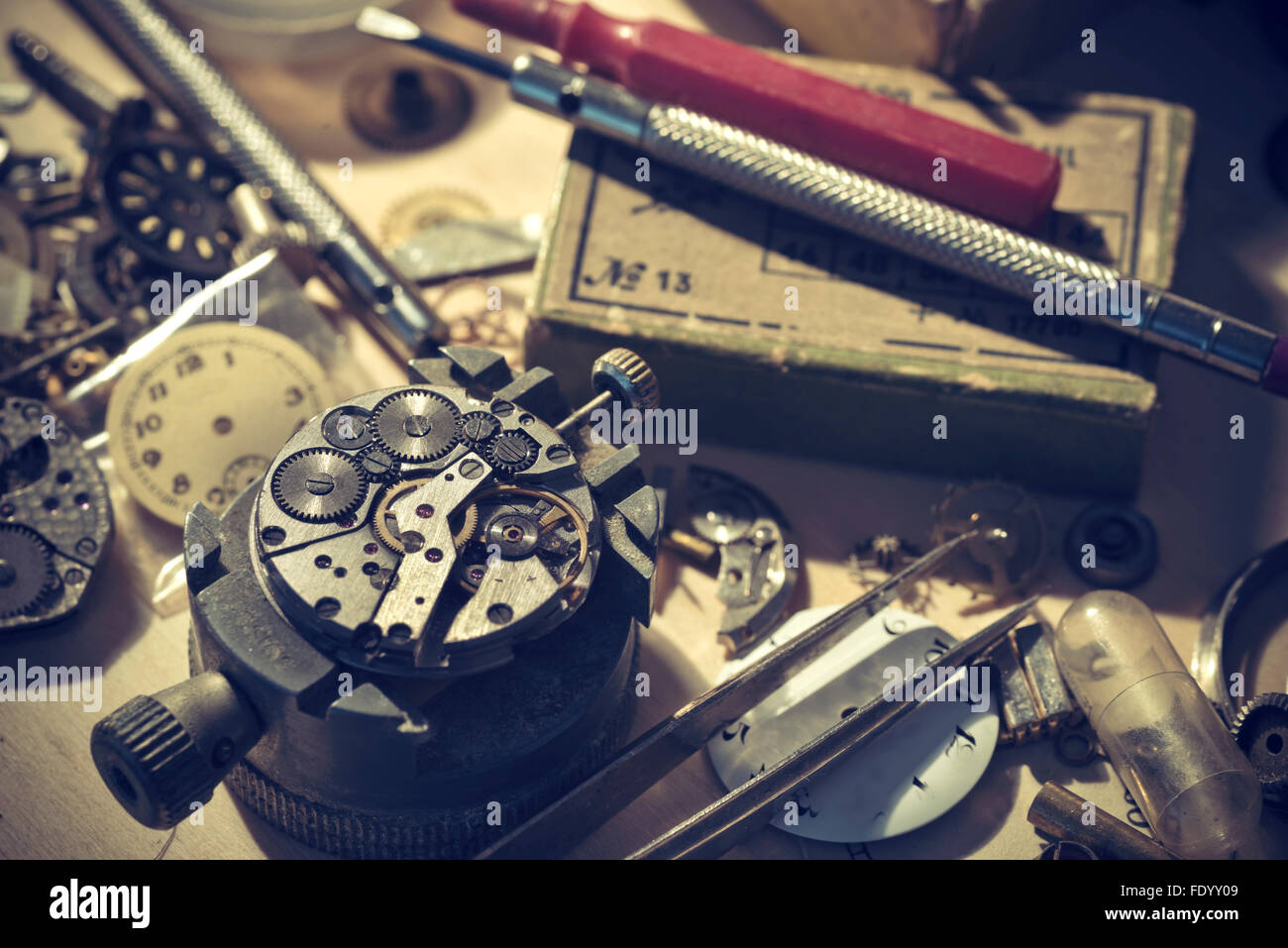 Old Watchmaker Studio. A watch makers work top. The inside workings of a vintage mechanical watch. - Stock Image