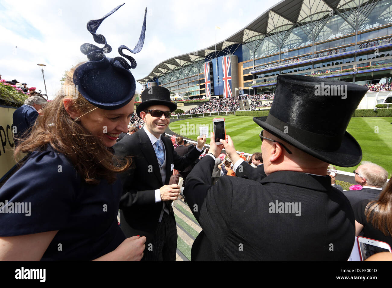 Ascot, United Kingdom, man with cylinder photographed a betting receipt - Stock Image