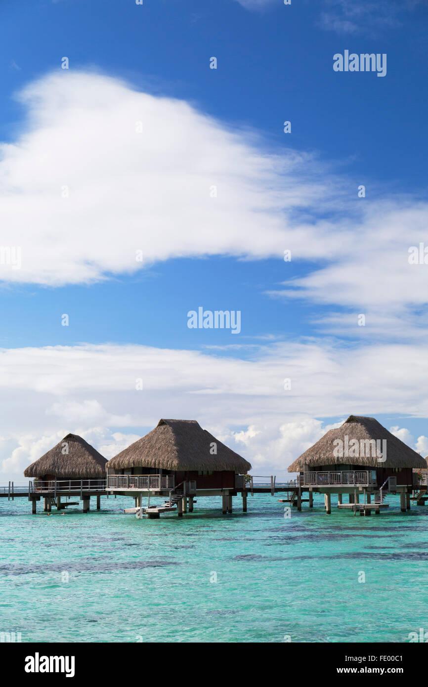 Overwater bungalows of Hilton Mo'orea Lagoon Resort Hotel, Moorea, Society Islands, French Polynesia - Stock Image