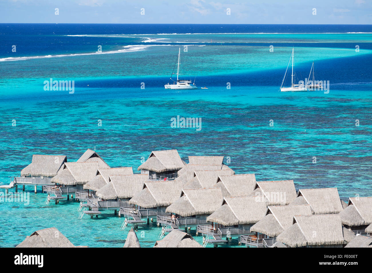 Overwater bungalows of Sofitel Hotel, Moorea, Society Islands, French Polynesia Stock Photo