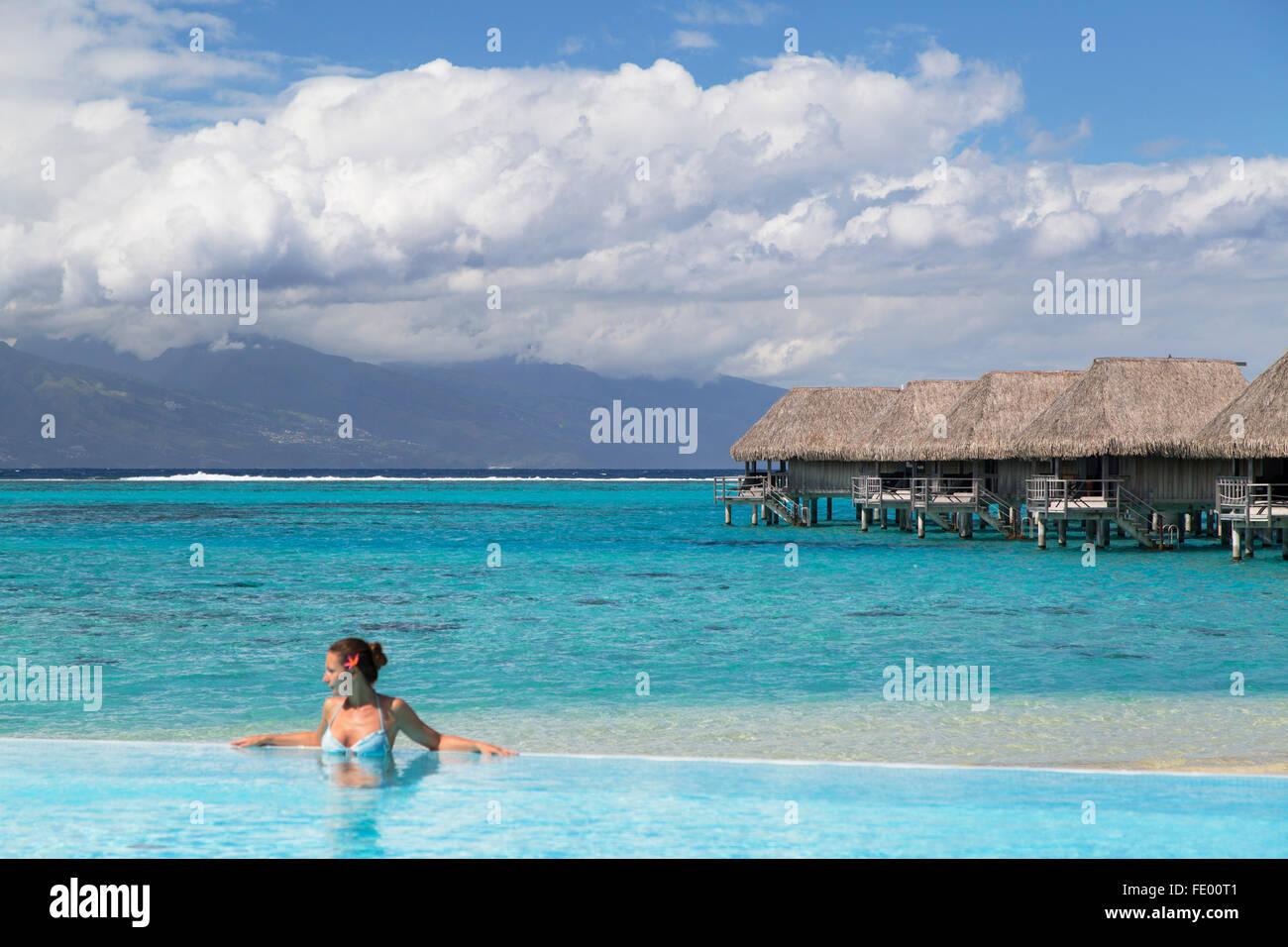 Woman in pool at Sofitel Hotel, Moorea, Society Islands, French Polynesia - Stock Image