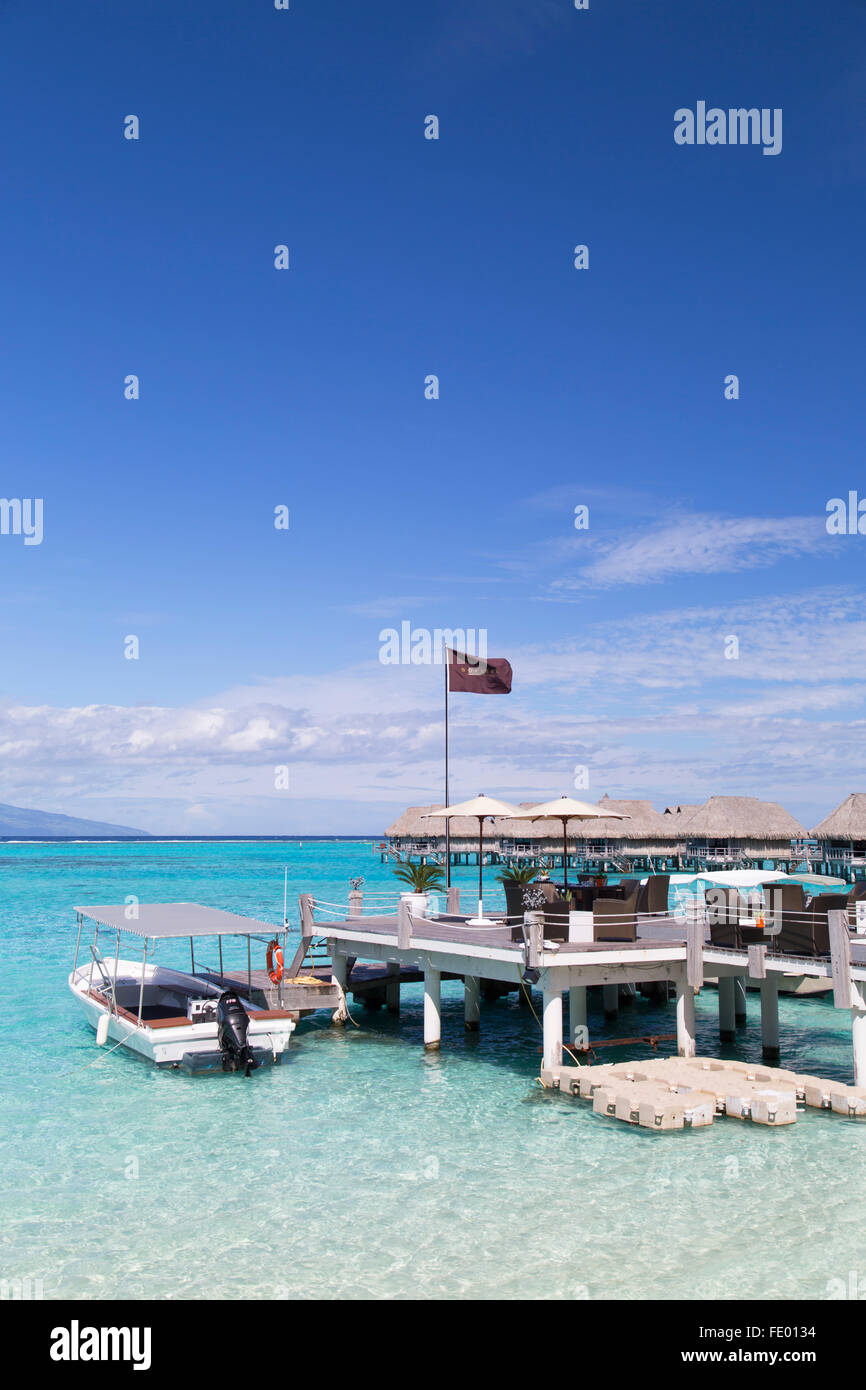 Jetty and overwater bungalows of Sofitel Hotel, Moorea, Society Islands, French Polynesia - Stock Image