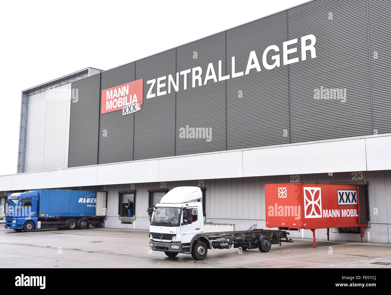 Mann Mobilia trucks are parked in front of the central warehouse of the furniture