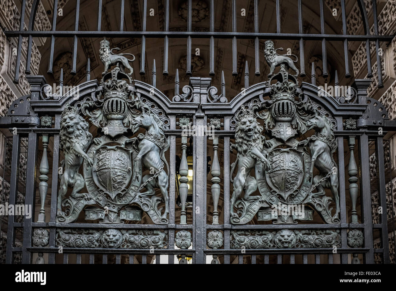 Lion and Unicorn designed metal double gates seen in closeup at Government offices in Great George Street, London, - Stock Image