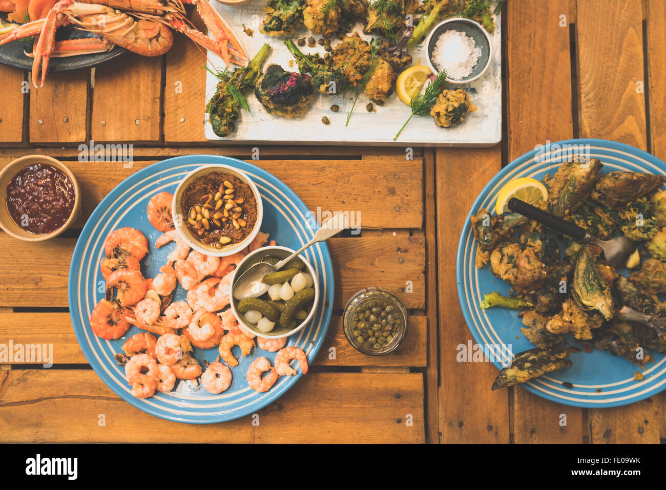 A bunch of tempura vegetables and prawns. - Stock Image